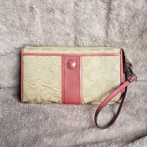 Pink and tan Coach wristlet/wallet